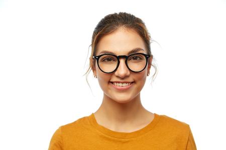 smiling student girl in glasses over white