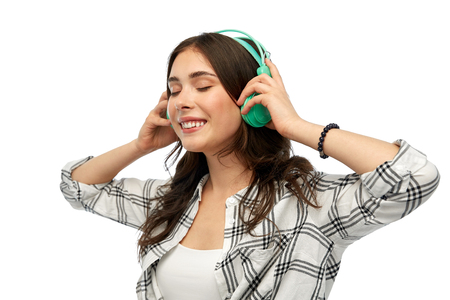 happy young woman or teenage girl with headphones Фото со стока
