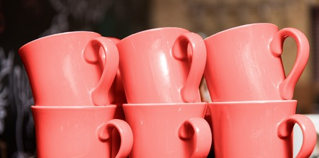 six stacked cups in trendy living coral color
