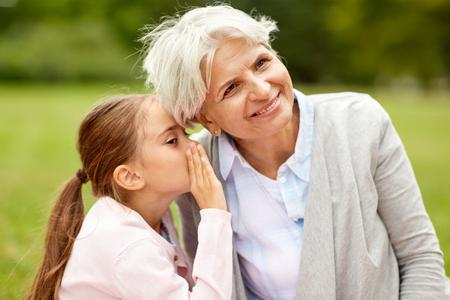 granddaughter sharing secrets with grandmother Standard-Bild