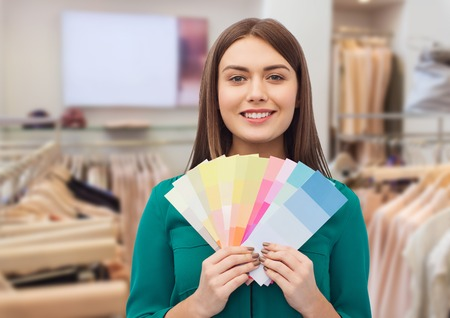 woman with color swatches at clothing store Stok Fotoğraf - 113368870