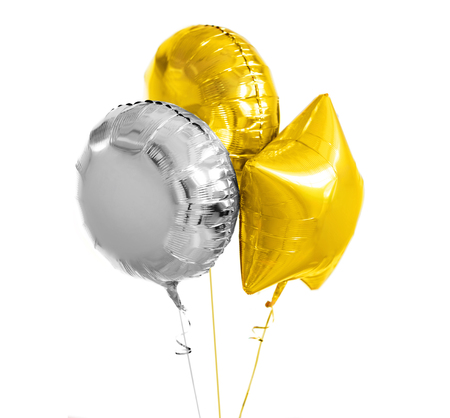 three gold and silver helium balloons on white