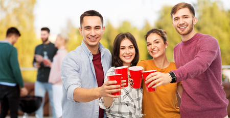 group of friends toasting drinks at rooftop party