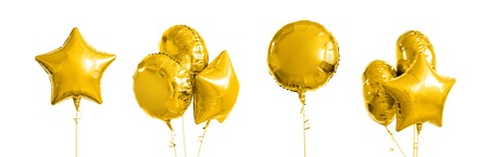 de nombreux ballons à l'hélium en or métallique sur blanc Banque d'images