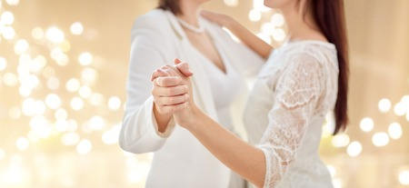 close up of happy married lesbian couple dancing