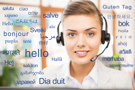 woman in headset over words in foreign languages Stok Fotoğraf