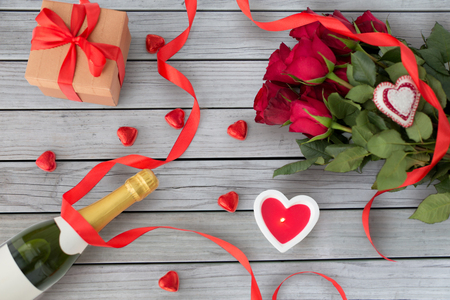 close up of champagne, gift, candies and red roses Stockfoto