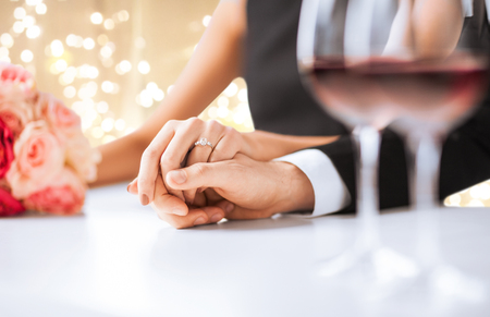 close up of couple holding hands at engagement Stock Photo - 113510924