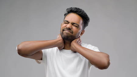 tired indian man suffering from neck pain Stock Photo - 113511207