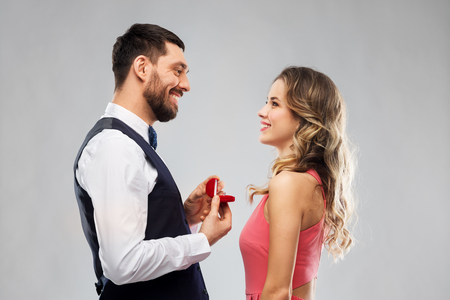 man giving woman engagement ring on valentines day Stock Photo - 113511211
