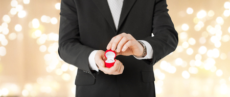 man with diamond engagement ring in red gift box Stock Photo
