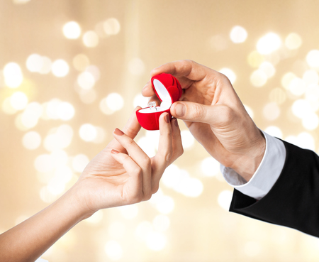 man giving diamond ring to woman on valentines day Stock Photo - 113658405