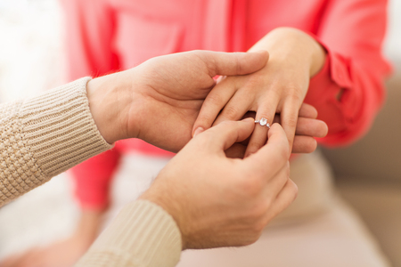 man giving diamond ring to woman on valentines day