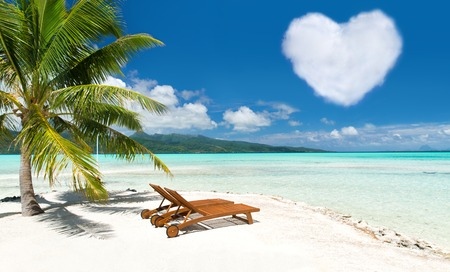 beach with two sunbeds and heart shaped cloud