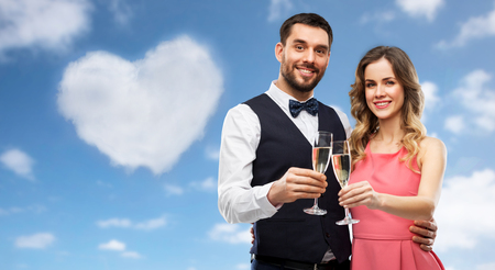 happy couple with champagne glasses toasting