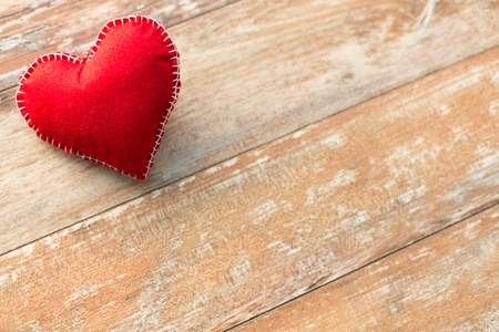 red heart shaped decoration on wooden background Stock Photo