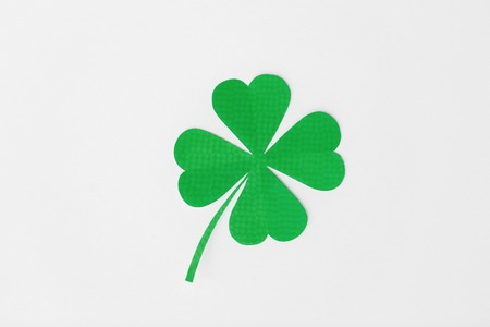 green paper four-leaf clover on white background