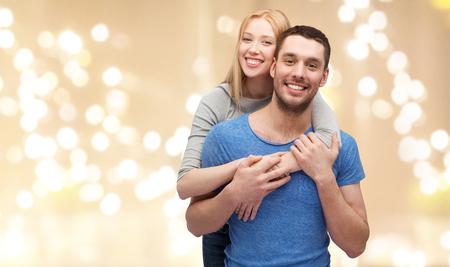 smiling couple hugging over festive lights