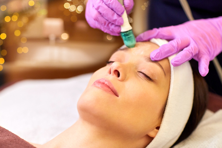 woman having microdermabrasion facial treatment Stock Photo