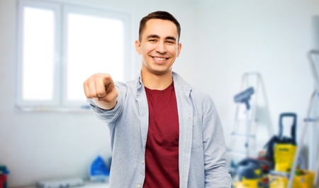 man pointing to you over home repair background