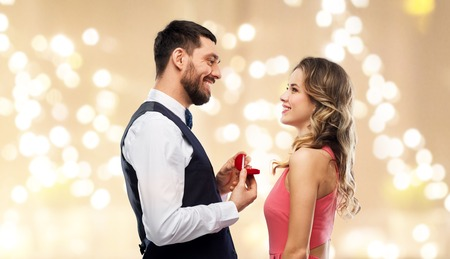 man giving woman engagement ring on valentines day Banco de Imagens