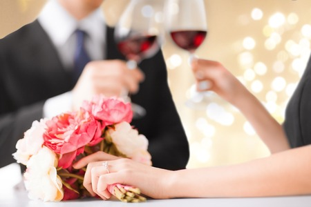 close up of engaged couple drinking red wine Stock Photo
