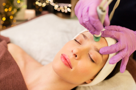woman having microdermabrasion facial treatment Фото со стока