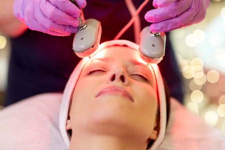 young woman having face microdermabrasion at spa Stock Photo