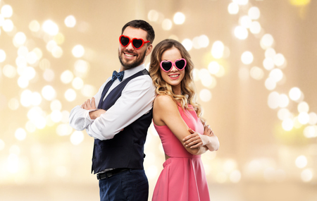 happy couple in heart-shaped sunglasses