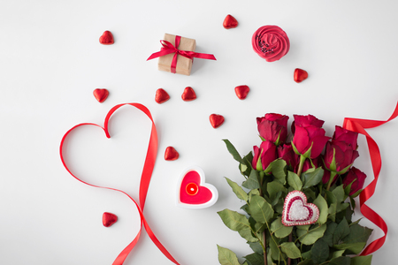 close up of red roses, gift, candies and candle Stock fotó