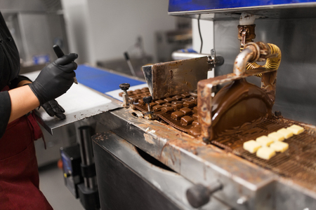 candies making by chocolate coating machine