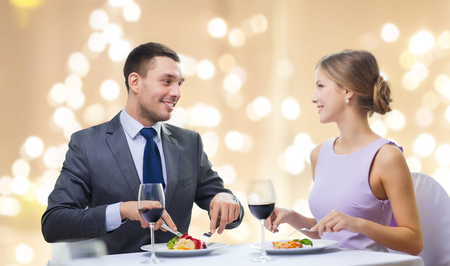 smiling couple eating main course at restaurant Archivio Fotografico - 115184842