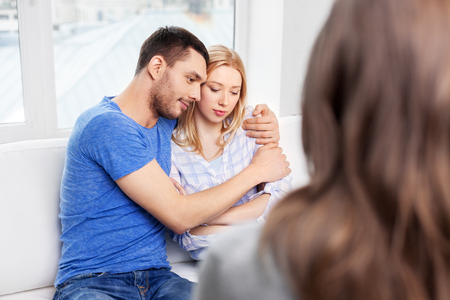 couple hugging at family psychologist office Stock Photo - 115184848