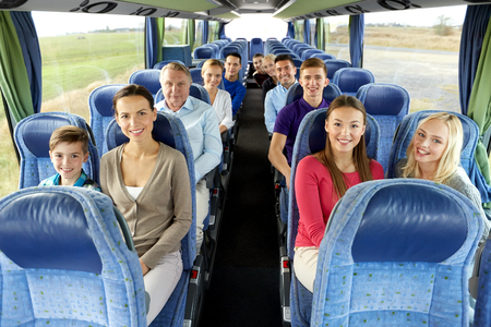 group of happy passengers travelling by bus Stok Fotoğraf