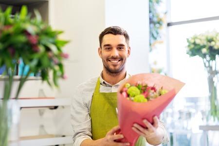 smiling florist man with bunch at flower shop Stok Fotoğraf