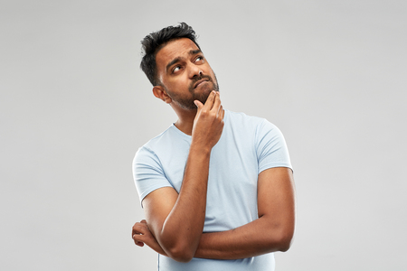 indian man thinking and looking up Stock Photo