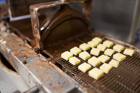 candies processing by chocolate coating machine