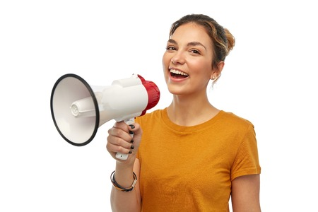 young woman or teenage girl with megaphone Stock Photo