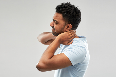 unhealthy indian man suffering from neck pain Stock Photo - 115181664