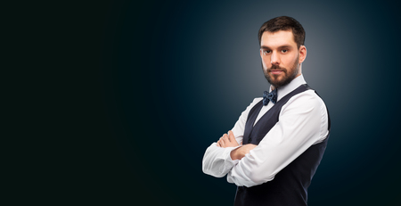 man in shirt and bowtie over black background