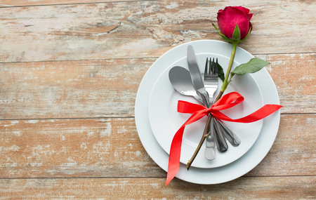 red rose flower on set of dishes Stock Photo