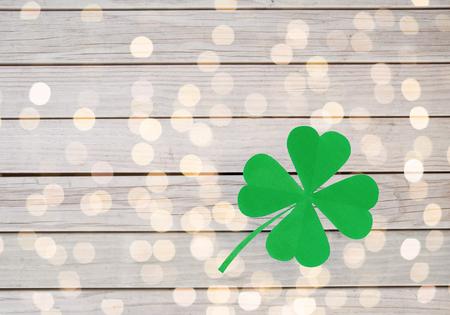 green paper four-leaf clover on wooden background Stok Fotoğraf
