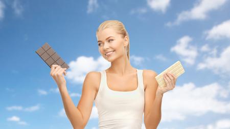 Woman choosing between dark and white chocolate
