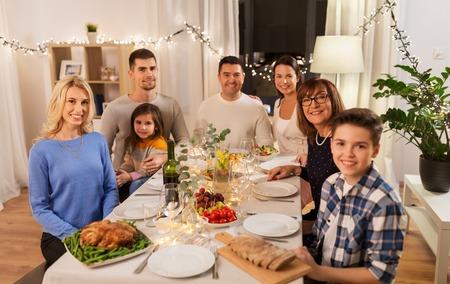Happy family having dinner party at home 版權商用圖片