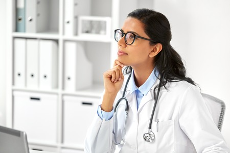 healthcare, technology people and medicine concept - indian female doctor in white coat with stethoscope at hospital Stock Photo
