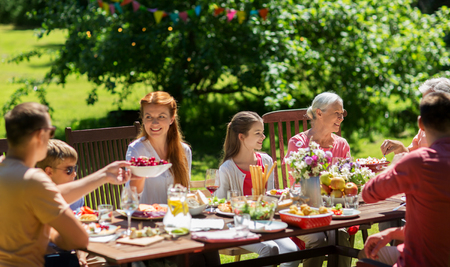 happy family having dinner or summer garden party Stok Fotoğraf