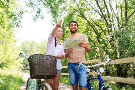 couple with map and bicycles at country in summer Фото со стока - 115751927