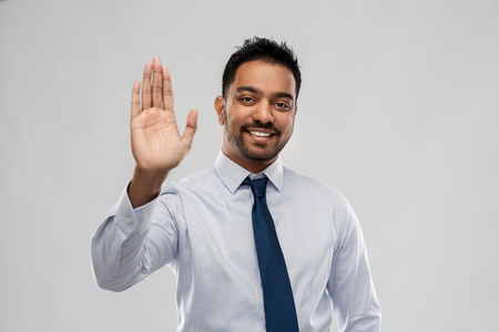 indian businessman making high five gesture 版權商用圖片