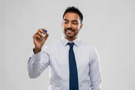 indian businessman in shirt with tie over grey