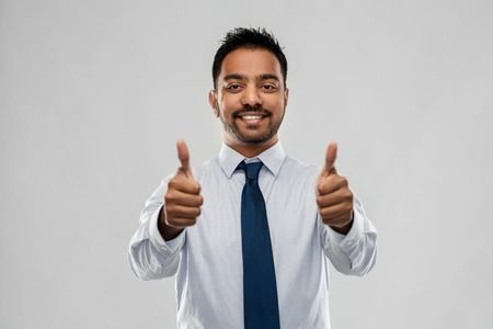 indian businessman showing thumbs up